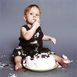 picture of baby with white, flowered icing, half-eaten birthday cake in front of him! This helps him tie in sign language concepts for birthday, cake, and party